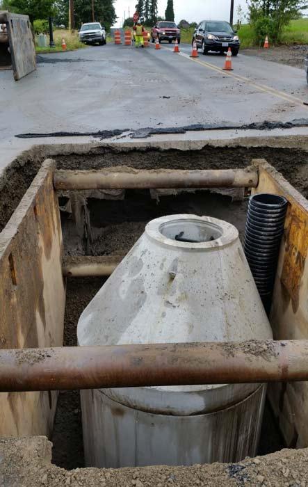 Manhole being installed